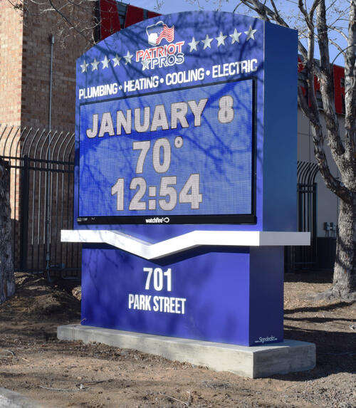 Patriot Pros Business Sign Displaying Date, Temperature, and Time.