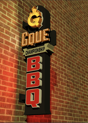 Gque Illuminated BBQ Sign in front of a brick wall