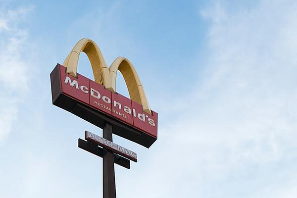 """McDonald's sign during daylight in front of a blue sky with soft white clouds. [<span>Photo by <a href=""""https://unsplash.com/@joia15?utm_source=unsplash&amp;utm_medium=referral&amp;utm_content=creditCopyText"""">Joiarib Morales Uc</a> on <a href=""""https://unsplash.com/s/photos/mcdonald%27s?utm_source=unsplash&amp;utm_medium=referral&amp;utm_content=creditCopyText"""">Unsplash</a></span>]"""